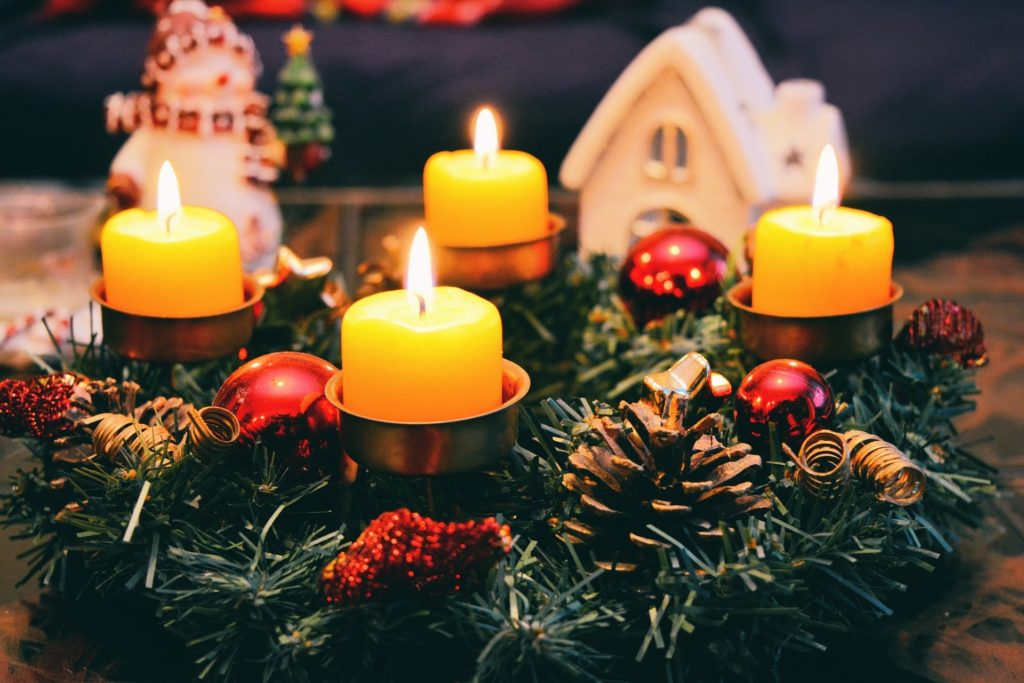 candles on a holiday wreath