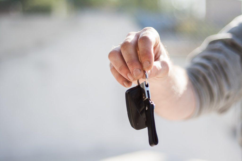 Hand holding set of keys