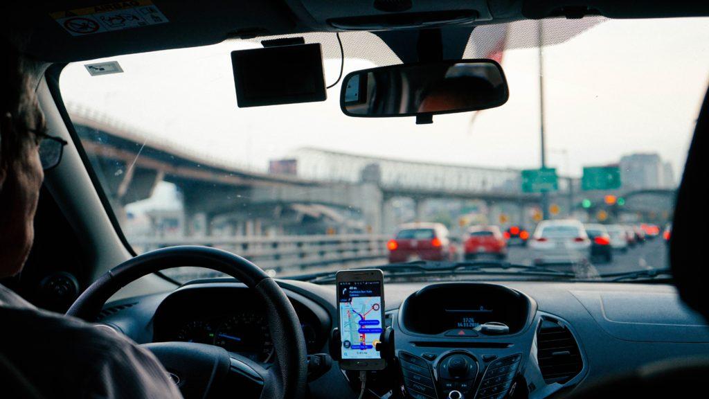 Older man driving car in heavy traffic