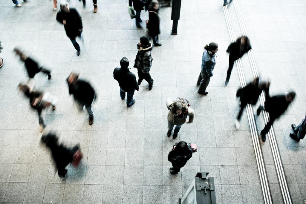people wandering in public space