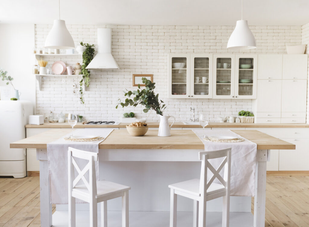 Beautiful white kitchen with kicthen island and stools