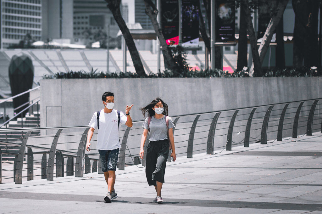Travellers wearing masks - How to Plan For Future Travel In The Time of COVID-19
