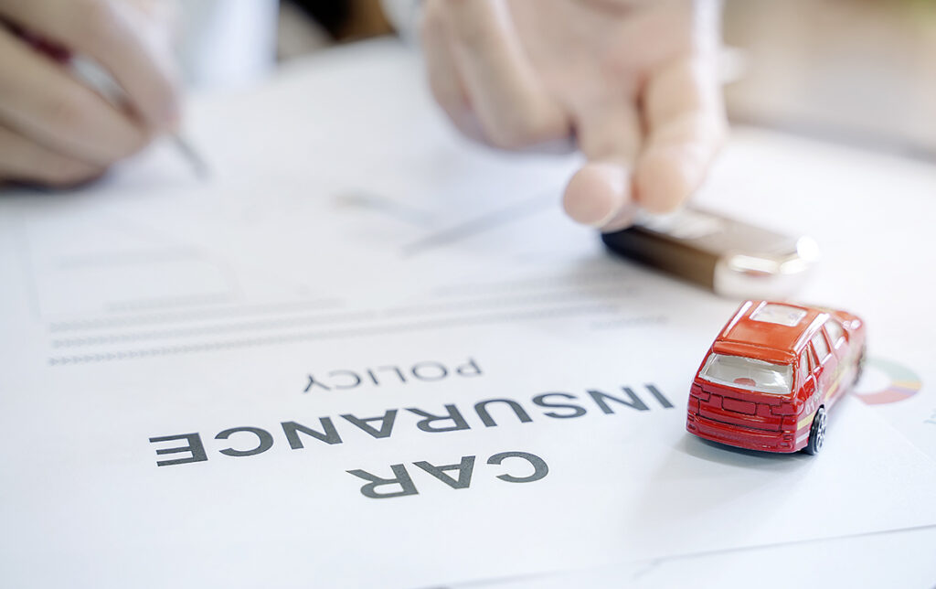 Insurance policy and a toy car