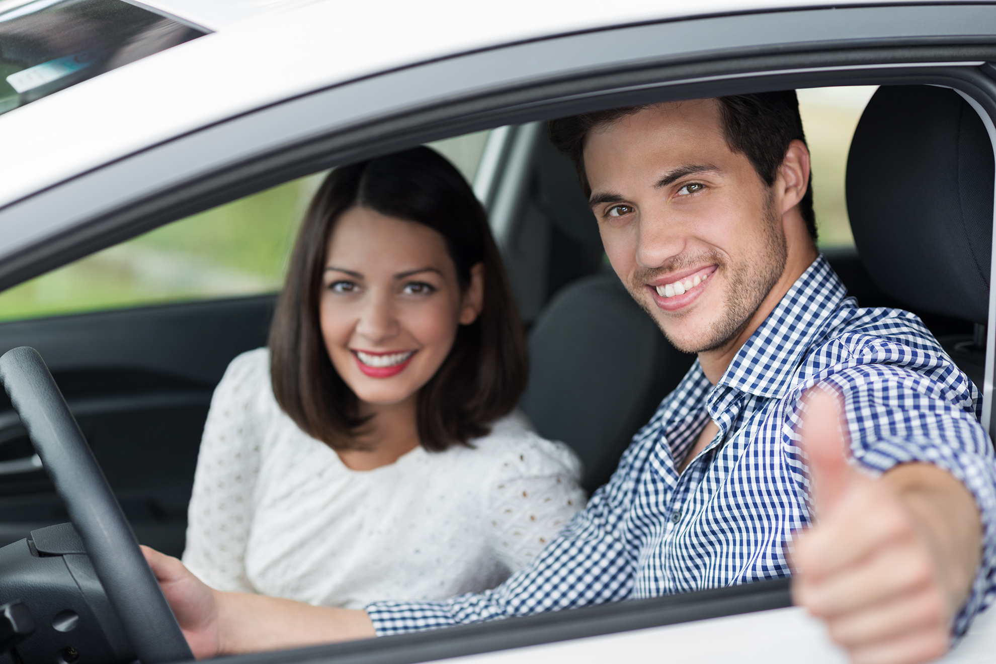 Smiling couple driving in a car